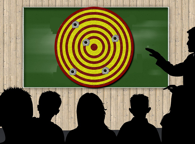 Class with  Gun Target on Chalk Board