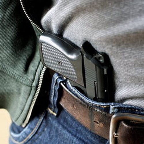 Gun in Holster with Jacket Pulled Back