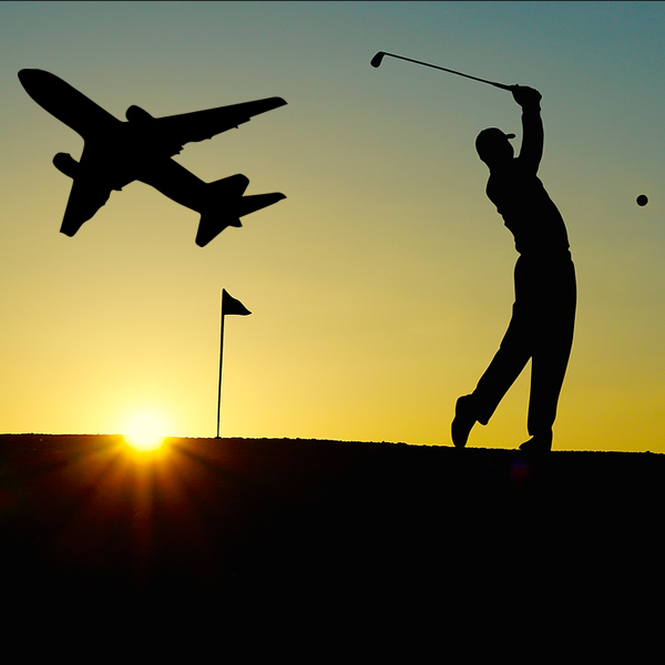 Golfer with Plane in Background