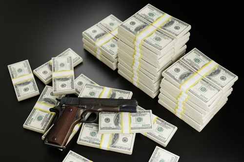 Pistol with Stacks of Cash