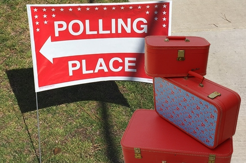 Polling Place Sign with Luggage