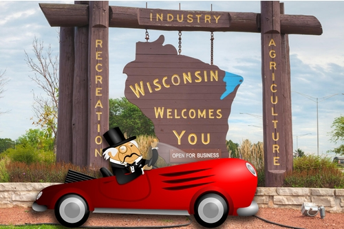 Rich Main in Sports Car in Front of Wisconsin Sign
