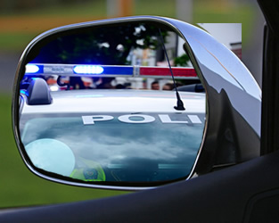 Police Car in Side View Mirror